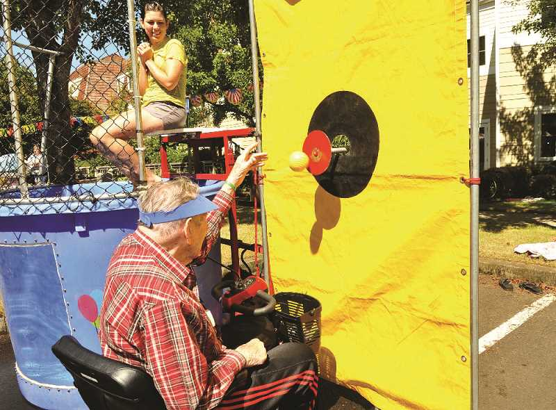 Jim Chase has some fun at the dunk tank at the annual SpringRidge Senior Carnival in August.