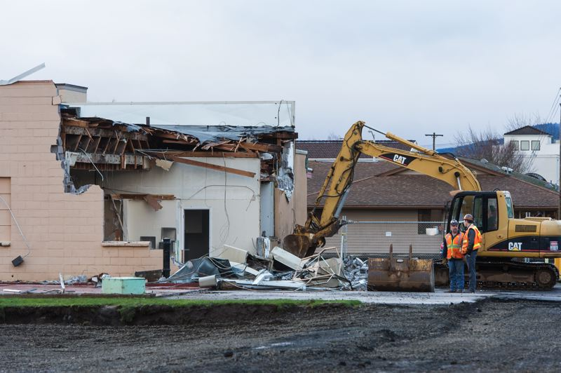 NEWS-TIMES PHOTO: CHRISTOPHER OERTELL - The building where the Cornelius City Council used to meet is being demolished to make way for the construction of Cornelius Place. Demolition started last week.