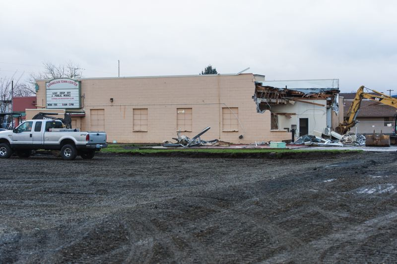 NEWS-TIMES PHOTO: CHRISTOPHER OERTELL - The former Cornelius Town Center is no more, with crews tearing down the old building this month.