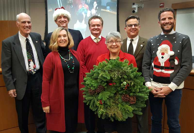 PHOTO COURTESY OF THE CITY OF LAKE OSWEGO - Mayor Kent Studebaker and the City Council pose for their annual holiday photo in City Hall (from left): Studebaker, Jeff Gudman, Jackie Manz, Skip ONeill, Theresa Kohlhoff, John LaMotte and Joe Buck.
