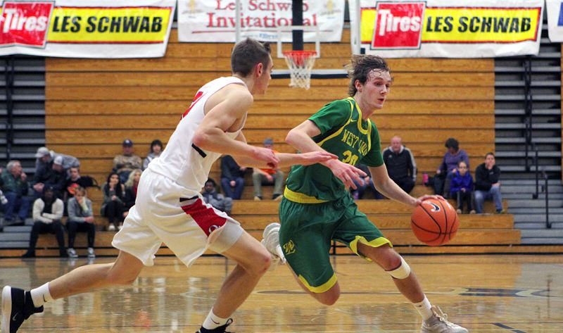 TIDINGS PHOTO: MILES VANCE - West Linn senior Jalen Thompson drives to the basket during his team's 77-52 win over Oregon City in the first round of the Les Schwab Ivitational on Wedesday at Liberty High School.