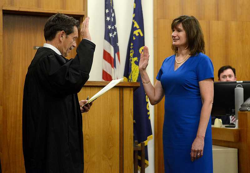 REVIEW PHOTO: VERN UYETAKE - Clackamas County Circuit Court Judge Robert Herndon administers the oath of office in August to former state Rep. Ann Lininger, making her the 31st judge in the county's history.
