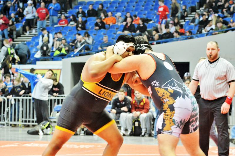 SPOTLIGHT PHOTO: JAKE MCNEAL - Miguel Olmedo won St. Helens High's first 285-pound state championship.