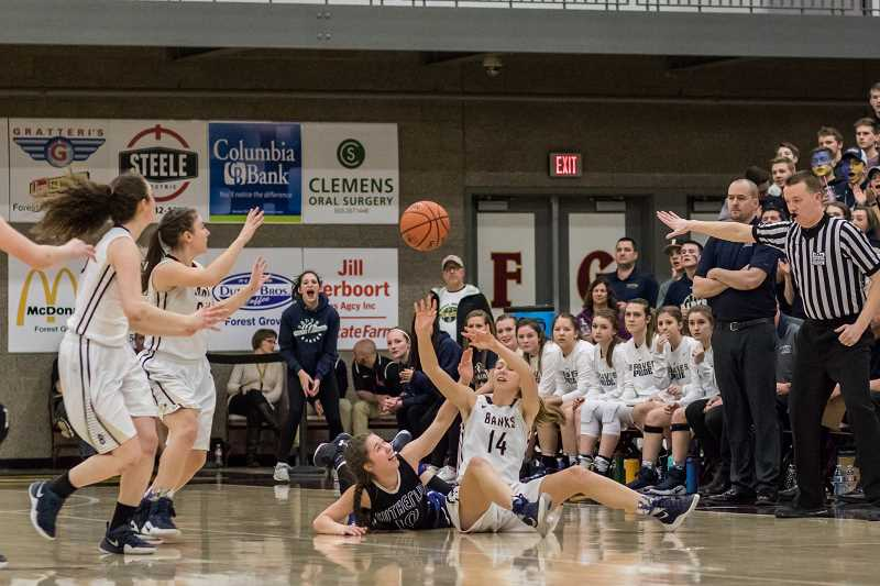 NEWS-TIMES FILE PHOTO: CHASE ALLGOOD - Banks' Aspen Slifka throws a pass after recovering a loose ball during the Braves' state final game versus Sutherlin last winter.