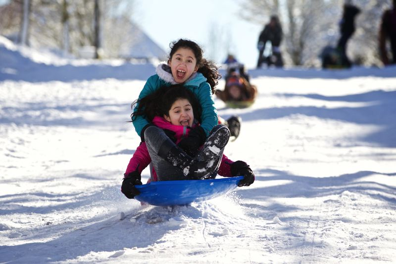 FILE PHOTO - Kids took advantage of last winter's unsual snow storms in the region. The headaches came for school officials, who faced up to nine snow days in their calendar.