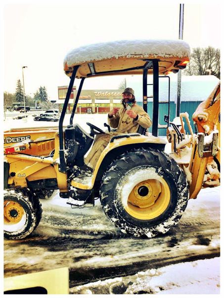 PHOTO COURTESY OF LACEY PLUMER - St. Helens Mayor Rick Scholl uses a tractor with a plow to remove snow and ice from roads amid a snowstorm that hit the region in January. Roads across the county remained icy and slick for roughly a week, making for unsafe driving conditions.