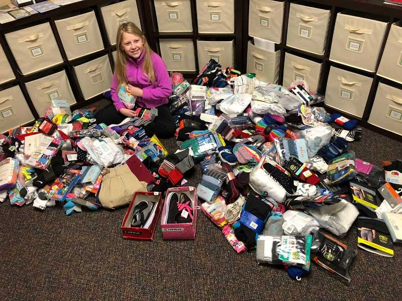 CONTRIBUTED PHOTO - Olivia Poehler provided a presentation at her school that resulted in a clothing closet being filled with donations.