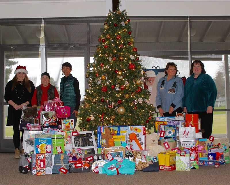 THE TIMES: MANDY FEDER-SAWYER - King City residents volunteered time and donated gifts for foster children in Washington County as a part of an annual event.