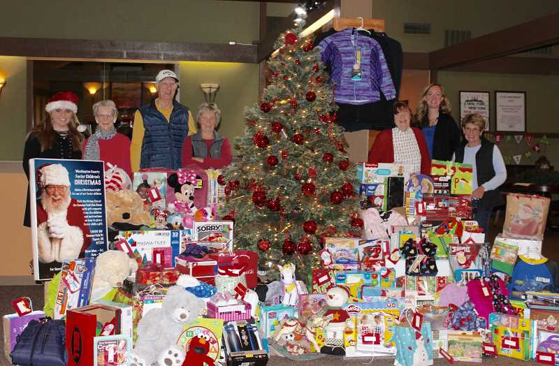 THE TIMES: MANDY FEDER-SAWYER - Summerfield residents and staff members enjoyed the spirit of giving as they participated in the annual gift giving event that provides foster youth with holiday presents.