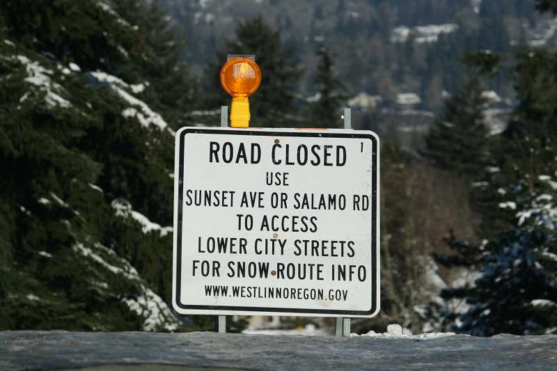 TIDINGS FILE PHOTOS - Just over a week into 2017, West Linn was blanketed with snow and ice that caused the city to virtually shut down.