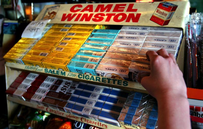PAMPLIN FILE PHOTO - Cigarettes for sale at the Clinton Street Pub in April 2009.