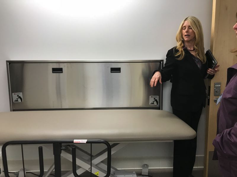 TRIBUNE PHOTO: SHASTA KEARNS MOORE - Chrystal Grey, Portland Public Schools program administrator for high school special education, shows the changing table in the bathroom in Franklin High Schools new special education unit.