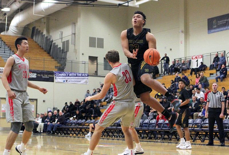 TIDINGS PHOTO: MILES VANCE - West Linn senior Keishon Dawkins goes up to score during his team's 71-59 loss to Mater Dei in the second round of the Les Schwab Invitational tournament at Liberty High School on Dec. 28.