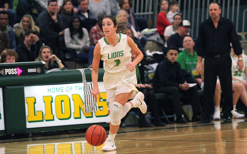TIDINGS PHOTO: MILES VANCE - West Linn senior guard Lexie Pritchard and the Lions have climbed to fourth in the latest Class 6A girls basketball coaches poll.