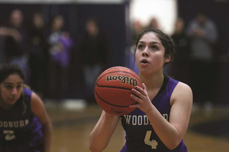 PHIL HAWKINS - Woodburn freshman Eliana Arechiga connects on one-of-two free throws en route to seven points in the Bulldogs' 44-38 loss to Sweet Home on Dec. 27.
