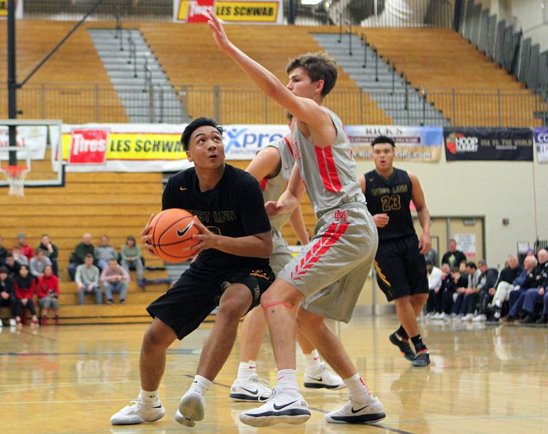 TIDINGS PHOTO: MILES VANCE - West Linn junior guard Drayton Caoile (shown here against Mater Dei) and the Lions went 2-2 in the Les Schwab Invitational tournament, losing in the fifth-place game on Saturday.