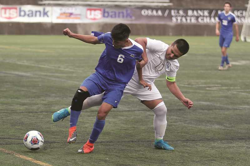 PHIL HAWKINS - Woodburn First Team All-State defender Salvador Perez (left).