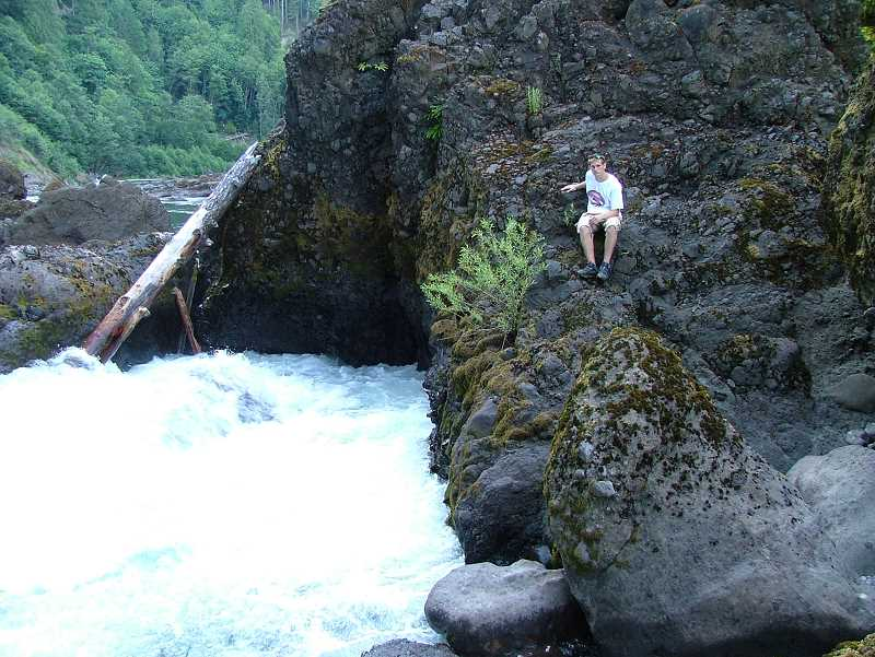 CONTRIBUTED PHOTO: PHIL LINGELBACH - Austin Lingelbach sits near the Killer Fang stretch of the Clackamas River. Lingelbach's father, Phil, says the family strives to go on an outdoor adventure each year.