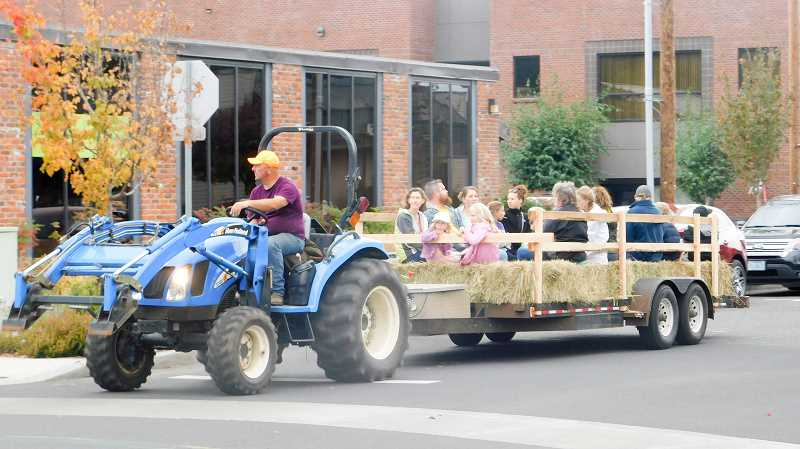 FILE PHOTO - Harvest Festival attendees enjoy a ride through the city last October. The event is one of several planned by the Estacada Downtown Comission, previously known as the Estacada Development Association.