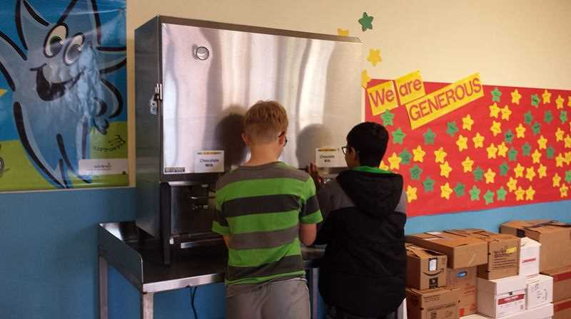Students at William Knight Elementary in Canby fill their own milk from a brand-new dispenser, an anomaly in Oregon public schools. Canby hopes to see the initiative grow, to reduce both milk carton trash and wasted milk.