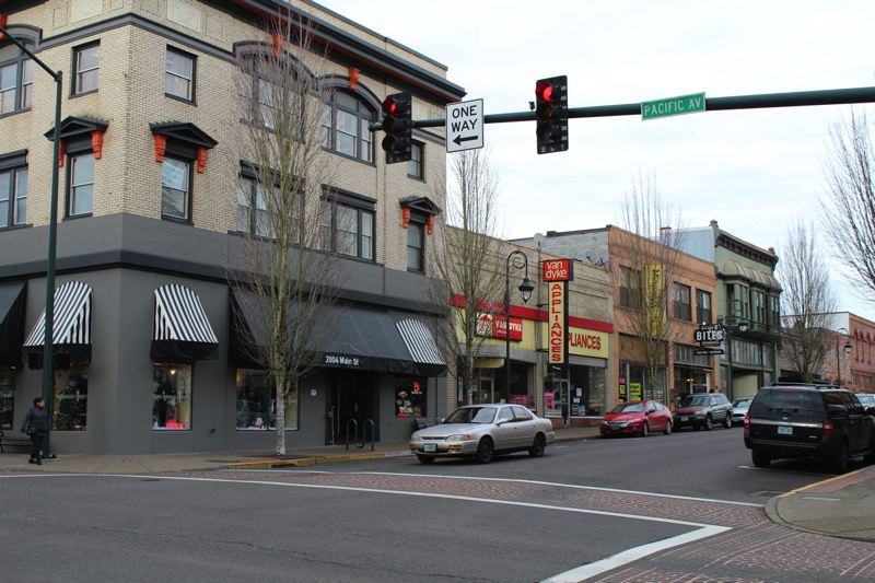NEWS-TIMES PHOTO: MARK MILLER - Downtown Forest Grove is home to many small businesses, including Van Dyke Appliances, Bites Restaurant and The King's Head Pub on Main Street.