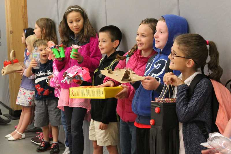 PAMPLIN MEDIA GROUP FILE PHOTO - Students are Trillium Creek Primary School in West Linn share creations made from recycled items. Disposal companies, schools and environmental groups often partner to bring learning opportunities into schools to help children learn the right way to recycle.