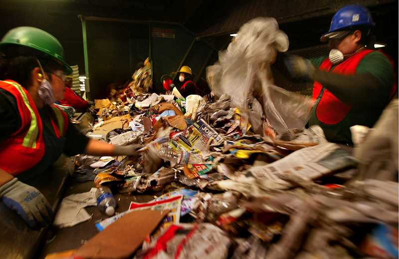 PAMPLIN MEDIA GROUP FILE PHOTO - Littering our recycling with items that cannot be used drives up costs -- more workers needing more time to sort -- and often contaminates whole lots of recycling so it cannot be sold.