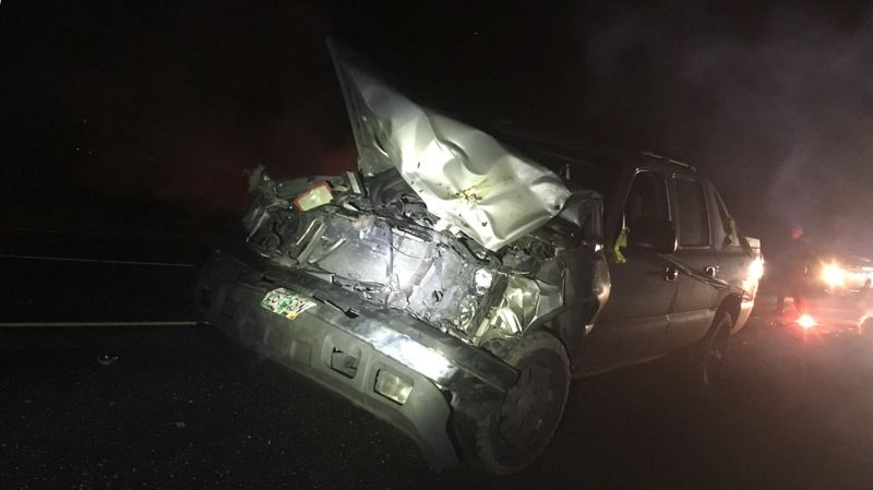 COURTESY OF THE WASHINGTON COUNTY SHERIFF'S OFFICE - The front of a car was smashed but no one was injured in an early-morning collision Thursday with elk on Highway 26 near Northwest Dersham Road.