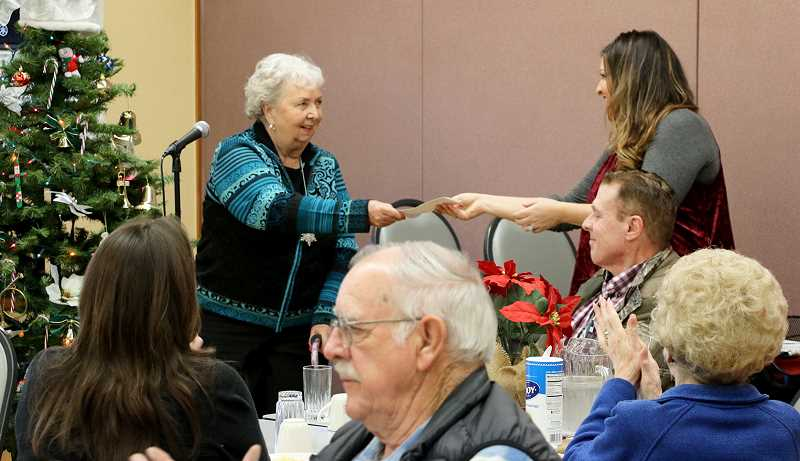 At the monthly meeting of the MACC, Molalla Communications made a special financial gift to the organization.