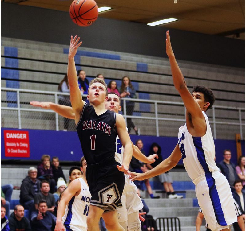 DAN BROOD - Tualatin High School junior Caden Dickson (1) puts up a shot during the Wolves''game at McNary last week.