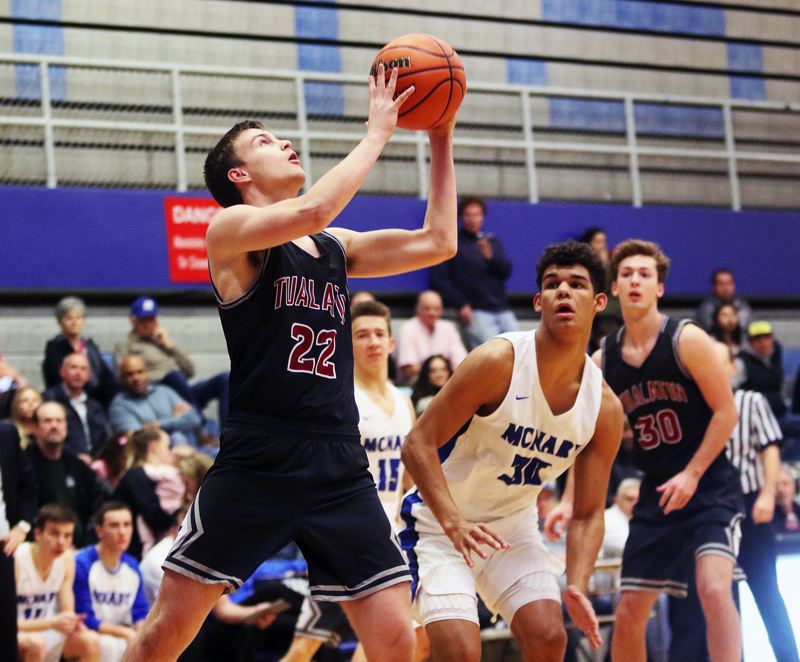 DAN BROOD - Tualatin senior Nathan Platter looks to go up to the basket during the Wolves' game at McNary.