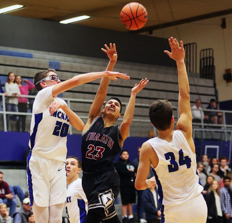 DAN BROOD - Tualatin senior Alexis Angeles puts up a shot during the Wolves' game at McNary.