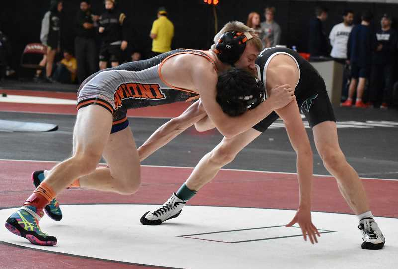 SUBMITTED PHOTO: BRIAN MOUNT - Molalla's Dustin Asher wrestles with Tigard's Cameron O'Conner in the quarterfinal round. Asher won by a 10-4 decision.