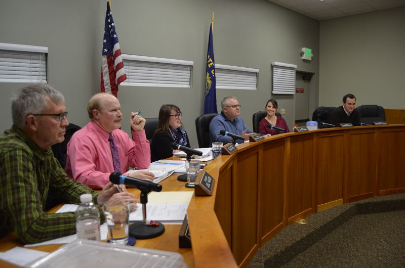 SPOTLIGHT PHOTO: COURTNEY VAUGHN - Scappoose city councilors conduct business during a council meeting Tuesday, Jan. 2. The council will appoint a new member to serve the rest of Rich Riffles term. Pictured left to right: Councilors Joel Haugen, Mark Reed, Natalie Sanders, Mayor Scott Burge, and Councilors Megan Greisen and Patrick Kessi.