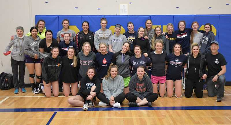 LON AUSTIN/CENTRAL OREGONIAN - Rosie Honl, far left, and Joel Kent, kneeling far right, are photographed with the former Rimrock Volleyball Club players who attended this year's tournament. All of the players photographed played at least some college volleyball.