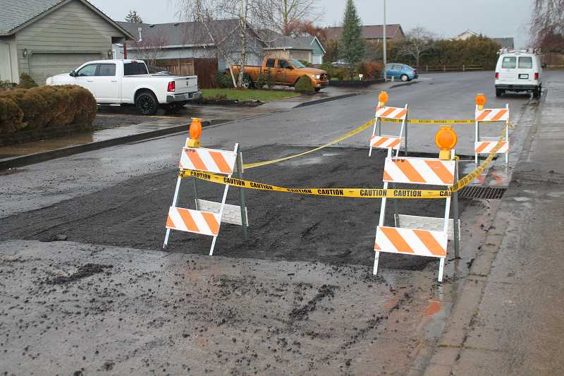 PIONEER PHOTO: CONNER WILLIAMS - A portion of Storey Drive near the water main rupture remain closed off Friday.