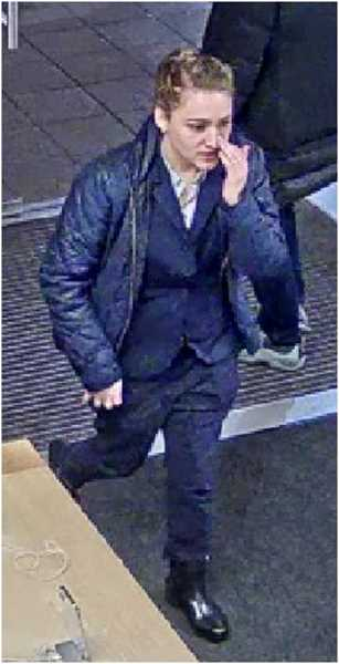 COURTESY OF TUALATIN POLICE DEPARTMENT - This woman, along with the accompanying man and woman, are believed to have something to do with a wallet missing from a Tualatin restaurant Dec. 28.