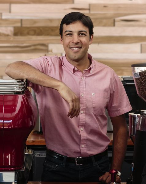 PHOTO: COURTESY NOSSA FAMILIA COFFEE - Augusto Carneiro owner of Nossa Familia Coffee of the Pearl District, imports beans but hopes to export roasted coffee with the Portland touch, to international markets.