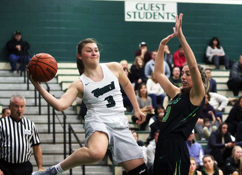 DAN BROOD - Tigard junior Campbell Gray (left) gets ready to throw a pass past West Linn senior Lexie Pritchard in Wednesday's game.
