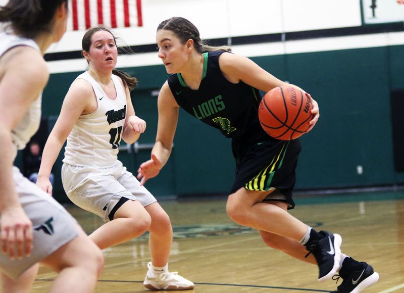 DAN BROOD - West Linn senior Kennedi Byram looks to drive with the ball during Wednesday's game at Tigard.