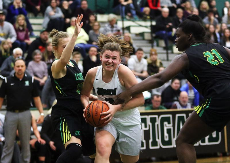 DAN BROOD - Tigard junior Campbell Gray tries to drive to the basket during the win over West Linn.