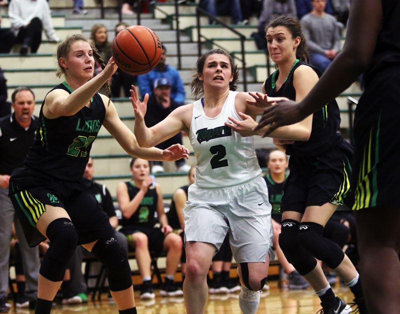 DAN BROOD - West Linn's Makayla Long (left) and Tigard's Kennedy Brown battle for a loose ball during Wednesday's game.