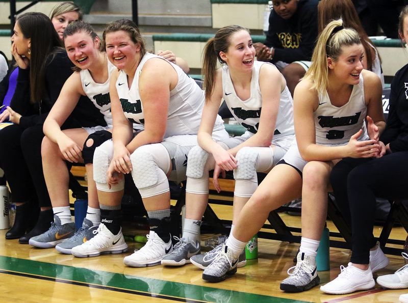 DAN BROOD - Tigard's (from left) Campbell Gray, Dani Lyons, Delaney Leavitt and Gabby McGaughey are all smiles during the final moments of Wednesday's game with West Linn.