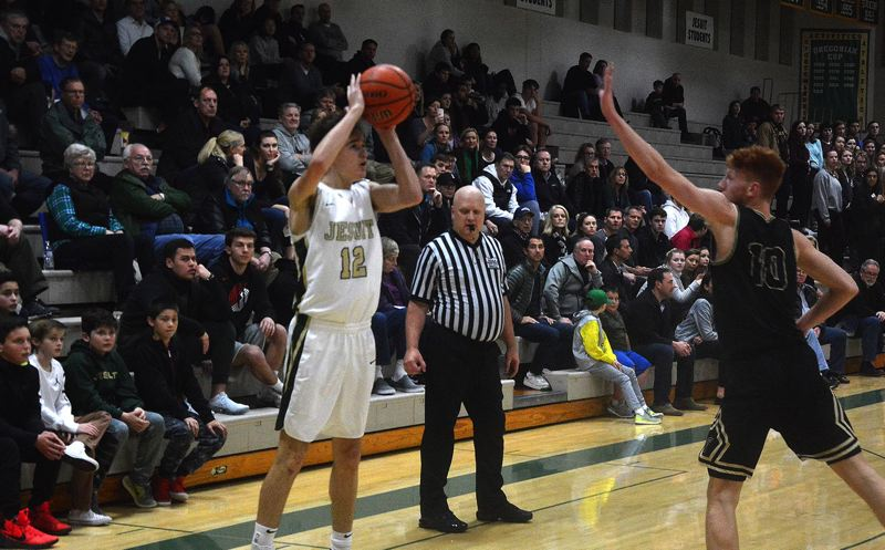 TIMES PHOTO: MATT SINGLEDECKER - Jesuit southpaw Justin Bieker puts up a three-point attempt against Southridge in Metro League action on Friday.