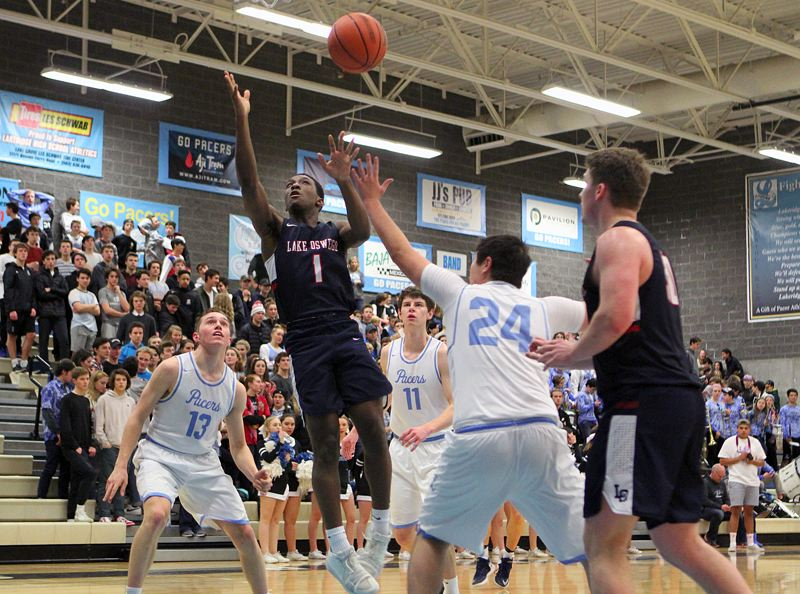 REVIEW PHOTO: MILES VANCE - Lake Oswego's Wayne McKinney loses control of the ball during his team's 70-53 win at Lakeridge High School on Friday night.