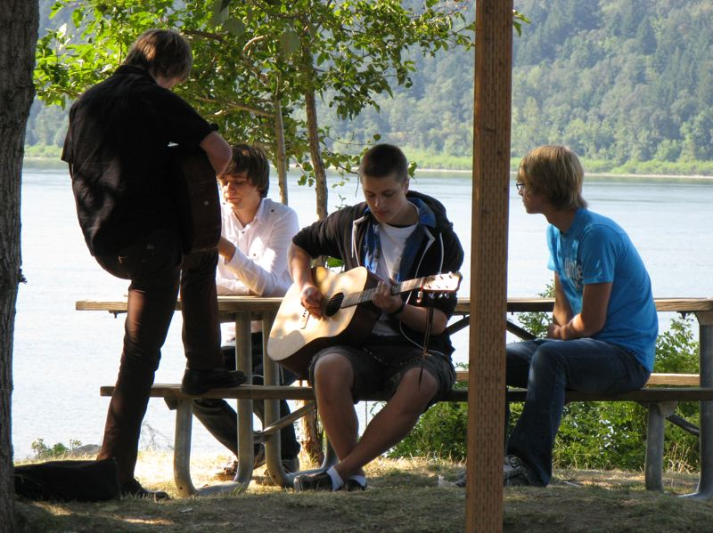 CONTRIBUTED PHOTO: OREGON STATE PARKS - Recreationists strum the guitar at Rooster Rock State Park along the Columbia River.