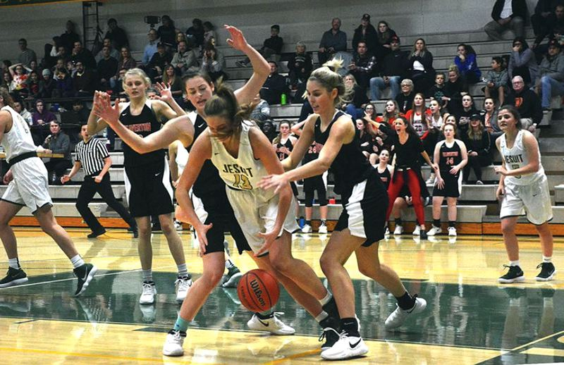 TIMES PHOTO: MATT SINGLEDECKER -  - Beaverton forwards Cierra Speck and Isabelle Potts put pressure on Jesuit in the second half of their win over the Crusaders on Jan. 3.