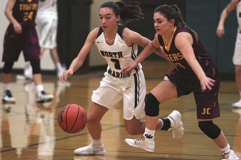 PHIL HAWKINS - North Marion freshman Mya Hammack stabs the ball lose and comes up with one of three steals she recorded in the Huskies' home win over Junction City on Thursday.