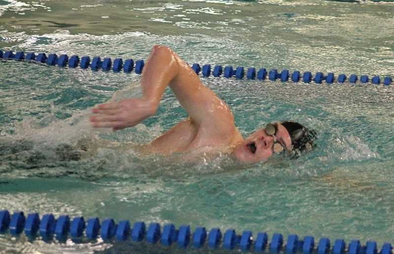 PIONEER PHOTO: CONNER WILLIAMS  - Molalla sophomore Linden Mackenzie swims in the boys 200 Yard Freestyle at the Indians' home swim meet