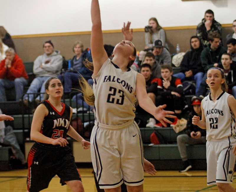 HILLSBORO TRIBUNE PHOTO: WADE EVANSON - Faith Bible freshman Izzy Steerman finishes a reverse lay-in during the Falcons' Jan. 8 game versus Neah-Kah-Nie at Forest Hills Lutheran School.